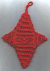 Photo of a knitted 4-pointed star Xmas ornament